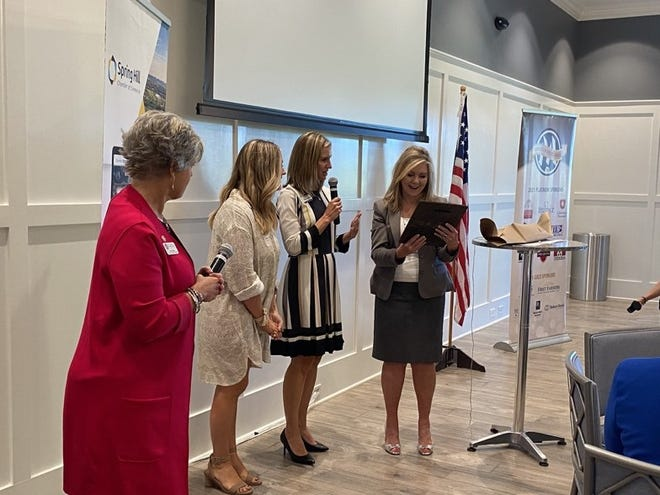 U.S Sen. Marsha Blackburn receives a custom made gift from Kaylyn Polinski with KEEPsake Kreations, documenting her monumental achievement as the first U.S. Senator from Tennessee, along with Rebecca Melton, executive director of the Spring Hill Chamber of Commerce and Kara Williams, director of the Chamber of Commerce for Maury Alliance.