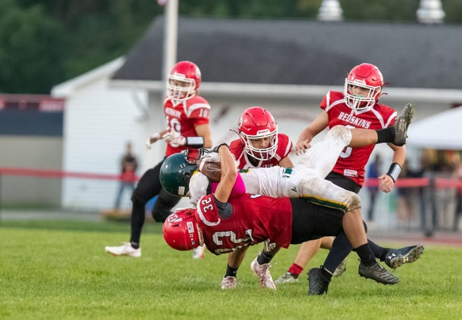 Canisteo-Greenwood's Tim Dale makes a tough tackle during Saturday's win over CG Finney.