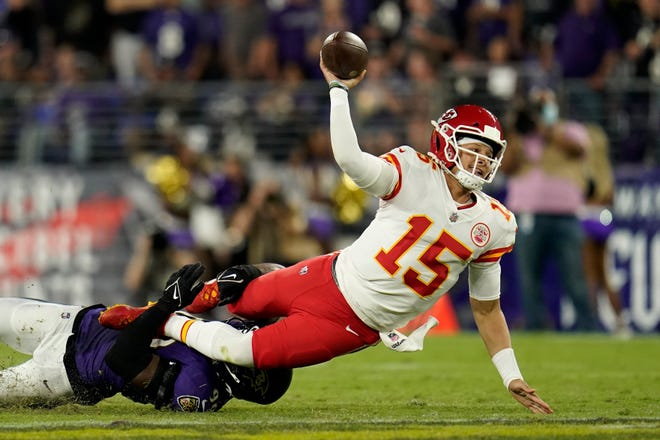 Kansas City Chiefs quarterback Patrick Mahomes makes a pass attempt as he is tackled by Baltimore Ravens linebacker Odafe Oweh in the second half of Sunday's game in Baltimore. Ravens cornerback Tavon Young intercepted the pass attempt on the play as Baltimore rallied for a 36-35 win.