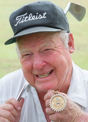 Billy Maxwell shows off the medal he earned for winning the 1951 U.S. Amateur. The PGA Tour winner and long-time golf club owner in Jacksonville died at the age of 92.