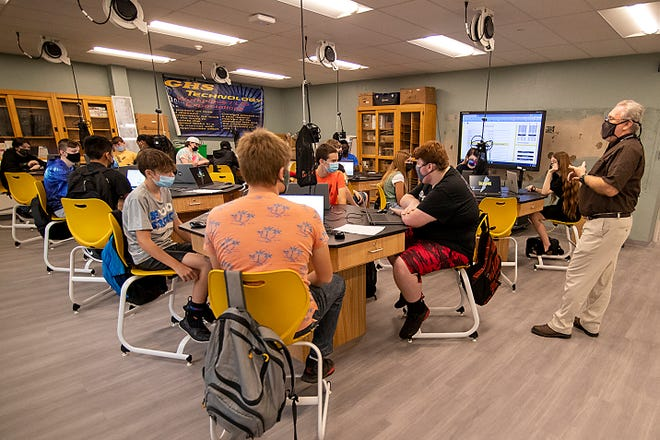 Galesburg High School teacher Russ Ulrich gives instructions to students in his newly-renovated computer classroom on the first day of in-school learning at GHS on Monday, Sept. 20, 2021. The Register-Mail is urging schools in Knox County to do a better job of reporting COVID cases and quarantines.