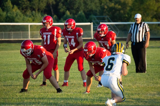 C-F Quarterback Kayden Hanning (14)  scans the Climax-Scotts defense during his pre-snap reads.