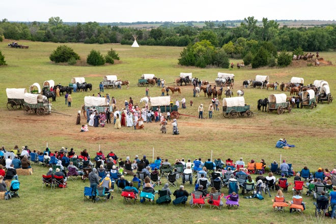 Settlers and their families park their wagons in a circle for the night on their way to the Northwest Territory during the Medicine Lodge Peace Treaty Pageant reenactment at Memorial Peace Park, Saturday, Sept 29, 2018.