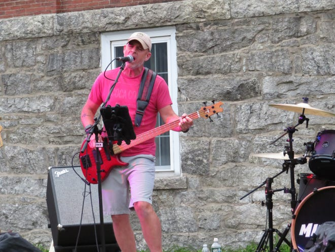 Millbury Town Manager Sean Hendricks plays bass for Mindrift, which performed at the Common on Sept. 16.