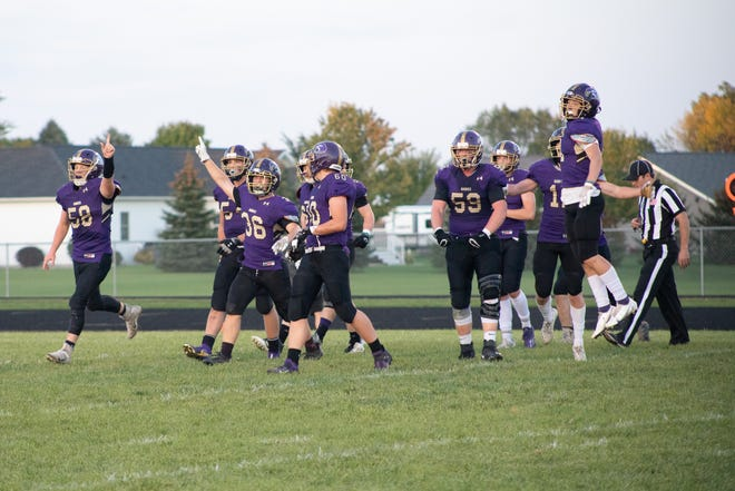 The team celebrates a fumble recovery in the game Friday.