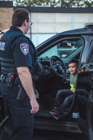 Children were able to explore a variety of vehicles including the police department's vehicles.