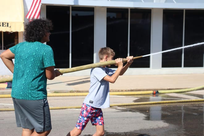 Kids battled it out in one division of the AppleJack Water Fights at the Nebraska City Fire Department immediately following the parade on Saturday, Sept. 18.