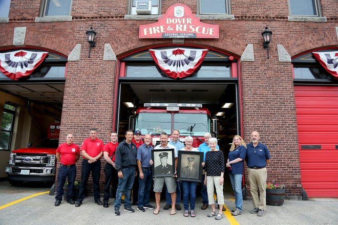 From left, Lt. Eric Anderson, Chief Paul Haas, Bradley Ruder, David Hanna,Gwenn Duffy, Dennis Turgeon, Ron Turgeon, Raymond Turgeon, Jeri Merrill, Stan Walker, Pam Phair, Sue Smith and Frank Santin honor Fallen Firefighter's Ernest LeBlanc and James Smith at the Dover Fire and Rescue Station on Friday afternoon.