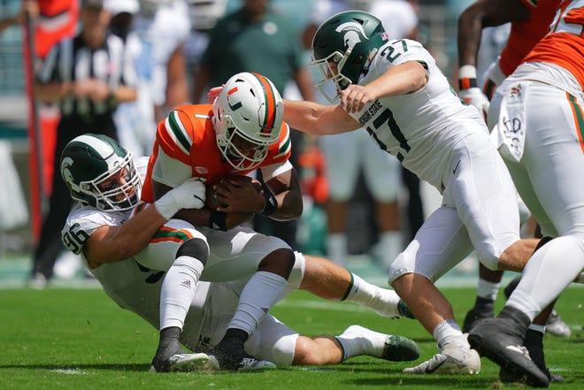 Michigan State defensive end Jacub Panasiuk sacks Miami quarterback D'Eriq King during Saturday's game at Hard Rock Stadium.