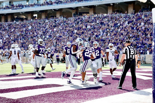 K-State Wildcat running back Deuce Vaughn celebrates with his teammates in the endzone after a score.