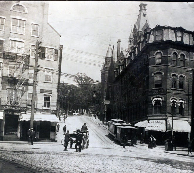 In the year 1900, cable cars were still operating in Providence. The new courthouse and the Rhode School of Design replaced some of the structures shown here.