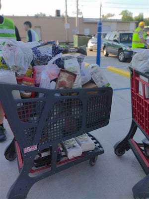 Nearly 200 families received grocery carts filled with healthy food items at St. James Caring Center's commodity day in September.