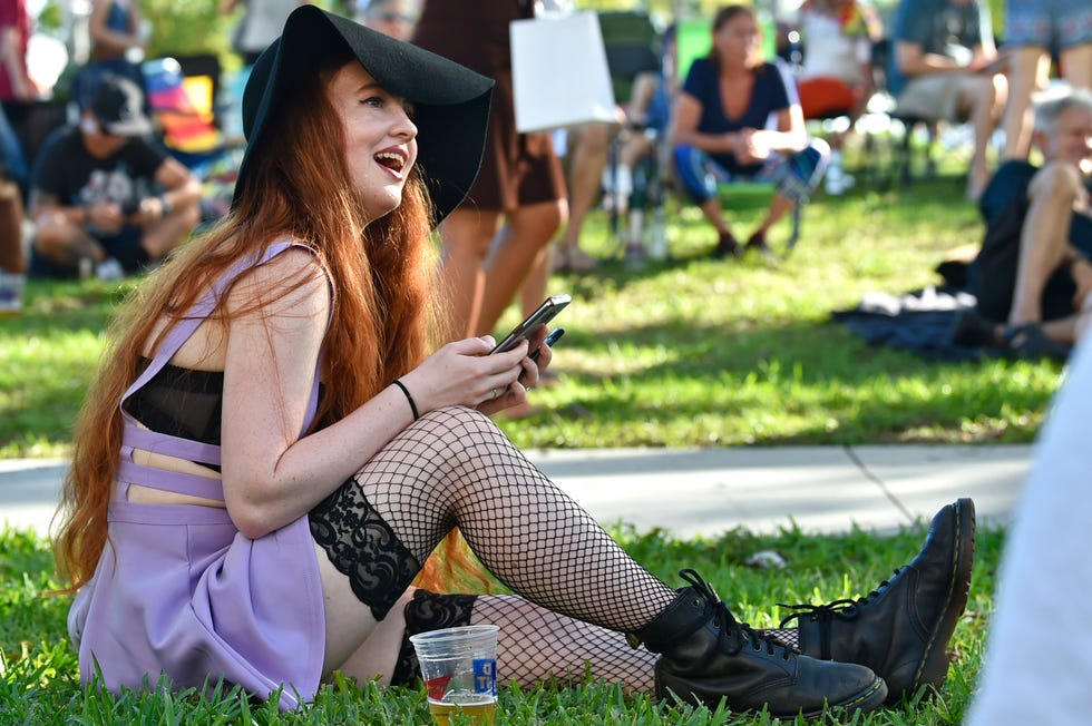Deidre Keating listens to her girlfriend, solo recording artist Linqua Franqa, off camera, both of Athens, Georgia, during the 2019 Harvey Milk Festival held at J.D. Hamel Park in downtown Sarasota. Harvey Milk Festival,now known as Fabulous Arts Foundation, combined this year's eventwith theFabulous Independent Film Festivalresulting in two weeks of LGBTQ funincluding Saturday'smusic fest, which will be held in an empty lotin the northern portion ofSarasota's Rosemary District on 10th Street.