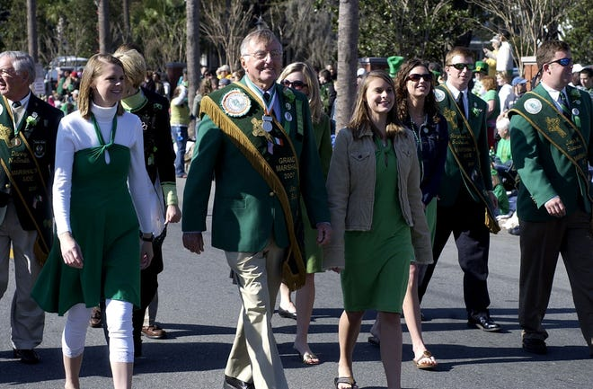 Grand Marshal John Burke walks with his family during the 2007 St. Patrick's Day Parade.