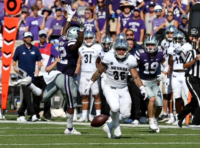 Kansas State linebacker Daniel Green (22) breaks up a pass intended for Nevada running back Toa Taua (35) during the fourth quarter Saturday at Bill Snyder Family Stadium.