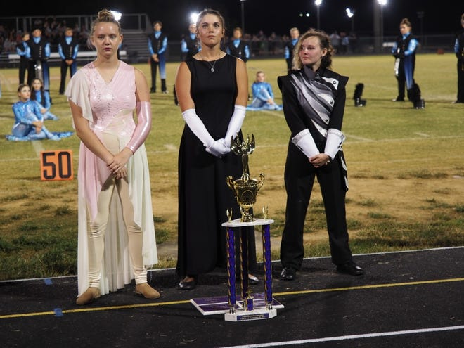 The Springs Valley Blackhawk Brigade earned the Best Music, Best General Effect, Best Drum Major and Best Visual at the Pride of Paoli Invitational. Pictured with their trophy are, from left to right, Kyliegh Marshall, Bostyn Rowlett and Chaeli Vernon.