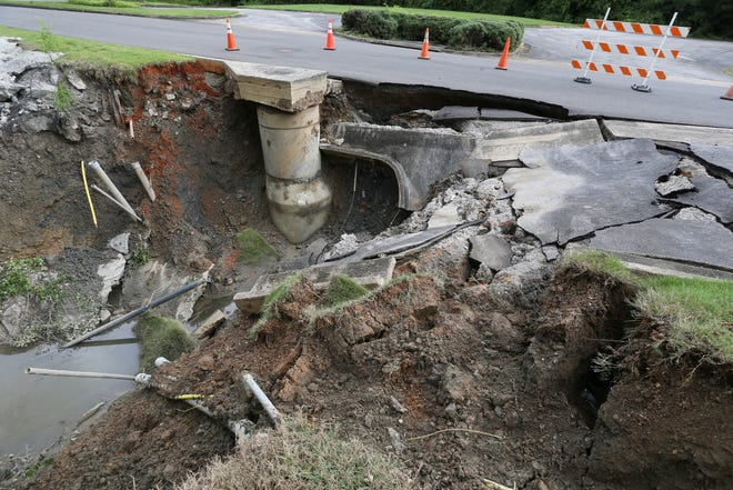 Heavy rains Saturday did damage in Tuscaloosa and Northport. A washout formed beneath Afflink Place, an access road near McFarland Boulevard and Rice Mine Road, claiming a part of the road as well as breaking subterranean pipes. The damage is seen Monday, Sept. 20, 2021. [Staff Photo/Gary Cosby Jr.]