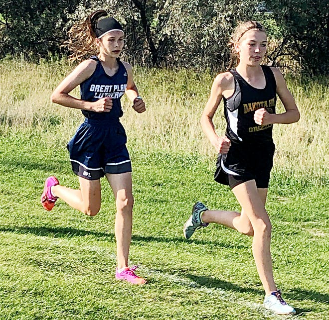 Sophomores Halle Bauer of Great Plains Lutheran (left) and Madison Zirbel of Dakota Hills, shown competing last week in the Aberdeen Roncalli Invitational, lead a strong group of cross country runners who are among this week's top area high school sports performers.