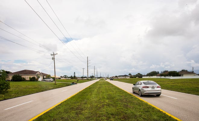 Traffic moves along Kismet Parkway between Andalusia Boulevard and Chiquita Boulevard in Cape Coral on Friday, September 17, 2021. LCEC is proposing adding electric  transmission lines the other side of the street of an existing FPL electric transmission lines in the same area.