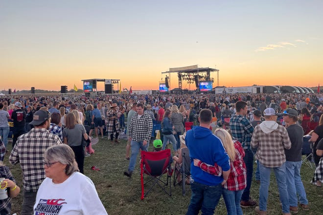 Livingston County Health Department officials say ticketholders may have been exposed to COVID-19. The sun sets behind the stage in the middle of a number of acts with a finale of Luke Bryan who hosted the Farm Tour concert Saturday, Sept. 18, 2021 in Conway Township.