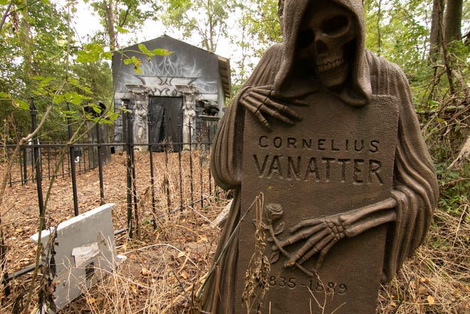 As Ghostly Grove visitors approach the end of the path, they encounter a spooky cemetery, shown Monday, Sept. 20, 2021. The haunt opens in October.