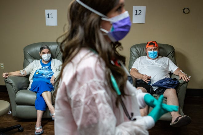 Nurse practitioner Katie Cornett, center, looks on as patients Kathy Barnett, 67, left, and Robert Collier, 55, receive monoclonal antibody infusions for their COVID-19 cases at the Primary Care Centers of Eastern Kentucky in Hazard. Sept. 20, 2021