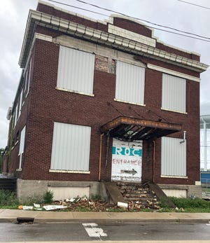 Bricks that had fallen off the front of the building at 800 S. Liberty St. were visible on the ground below on Sept. 20, 2021.