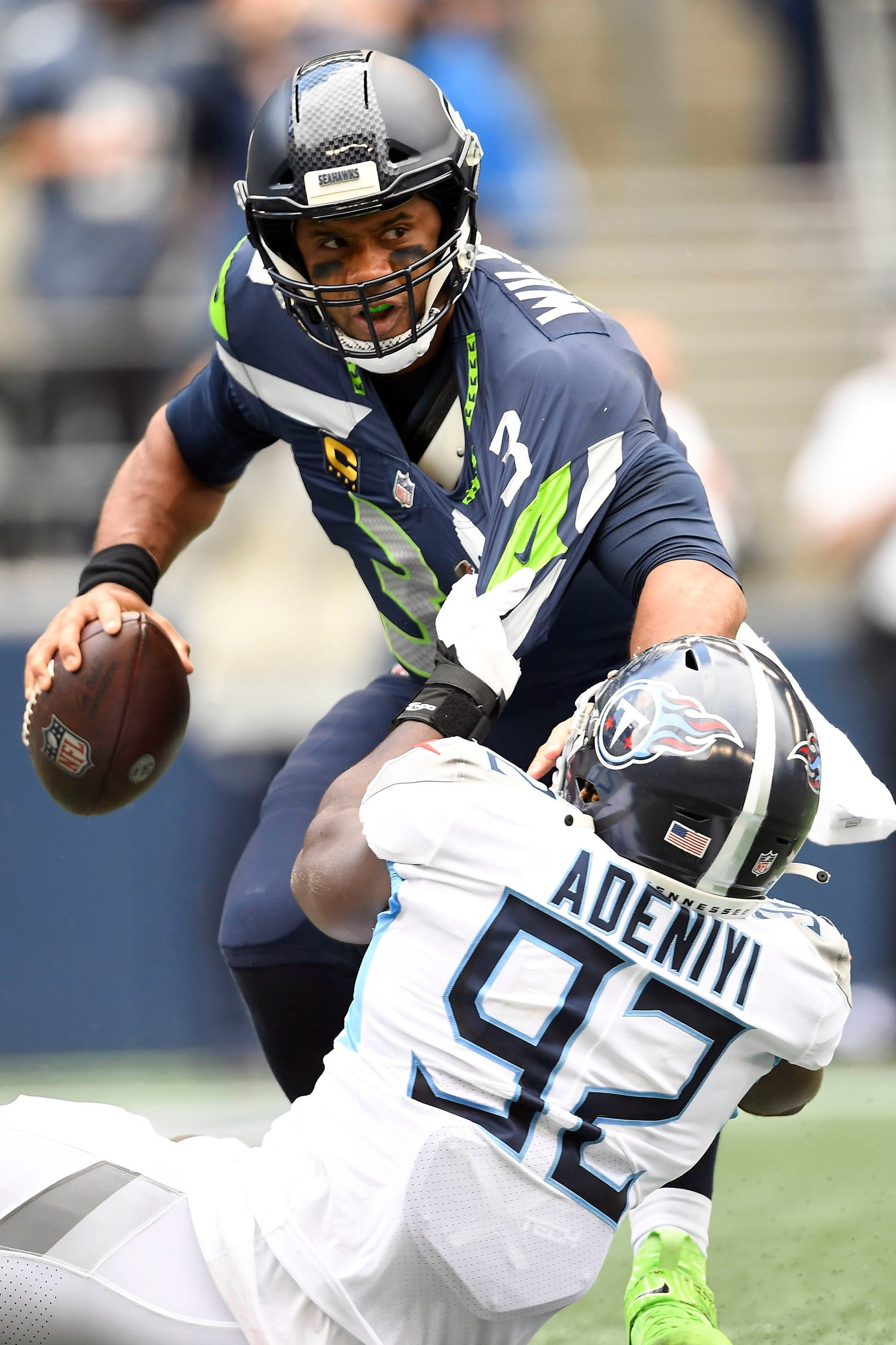 Tennessee Titans linebacker Ola Adeniyi (92) sacks Seattle Seahawks quarterback Russell Wilson (3) for a loss of yards in overtime at Lumen Field Sunday, Sept. 19, 2021 in Seattle, Wash.