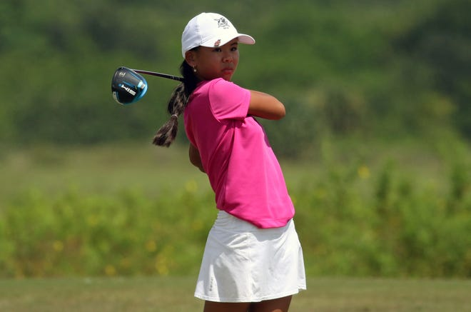 Gulf Coast freshman Ann-Sophie Bourgault tees off on the 18th hole on Monday at the Crutchfield-Hawkins Girls Golf Tournament at River Greens Golf Course in Avon Park.