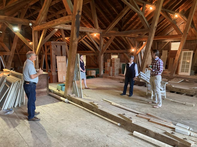 From left, Bruce Cramer, Theresa Contini, Candi Moore and Adam Gibbs survey the second floor of the historic horse barn behind Bryn Du Mansion. Current plans call for an approximately $2.1 million restoration of the barn to create a new home for the LCCC.