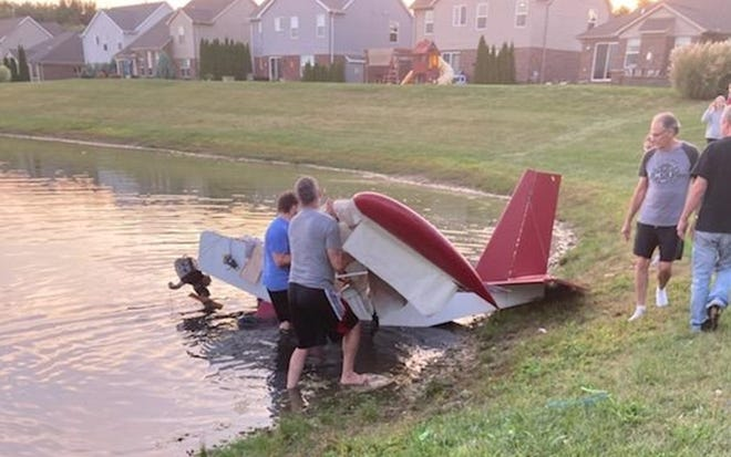 Lyon Township residents rushed to help when an ultralight glider plane crashed into a nearby pond on Sunday, Sept. 19.