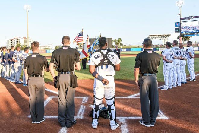 Blue Wahoos players gather for National Anthem on Sept. 11 before game with Biloxi Shuckers.