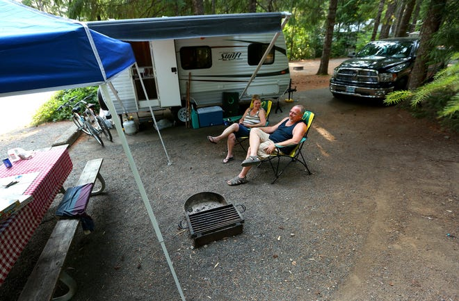 Bonnie and Robert O'Daniel relax at their campsite at Detroit Lake State Park campground in Detroit.
