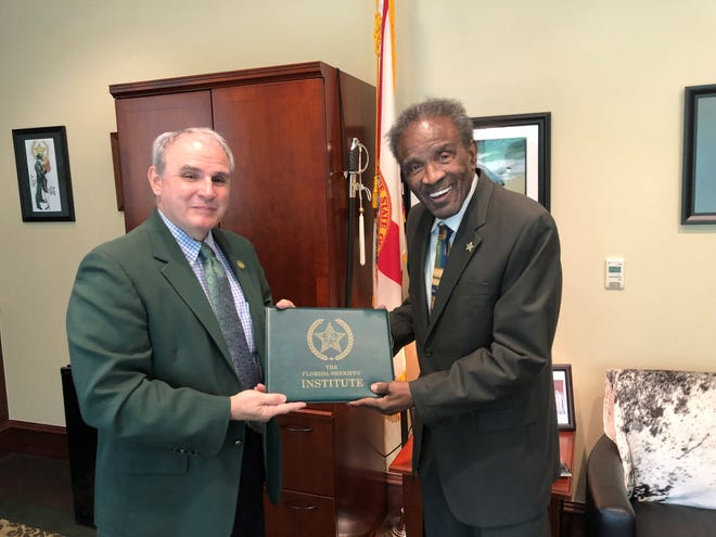 Tallahassee resident Charles Scriven, 91, receiving the Distinguished Service Award from Florida Sheriffs Association Executive Director Steve Casey on Sept. 13, 2021.