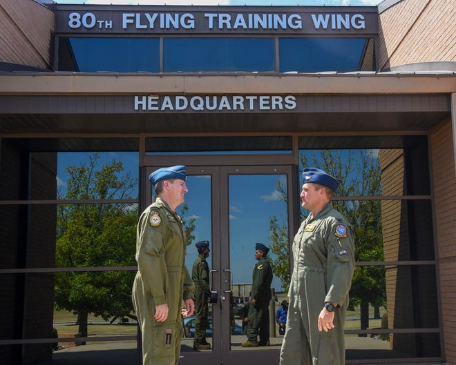 2 Canadian Air Division Commander and steering committee chairman, Brig. Gen. Denis O'Reilly (left), and 80th Flying Training Wing Commander, Col. Bob Haas, talk in front of the wing headquarters at Sheppard Air Force Base Friday.