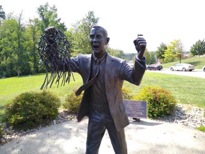 Statue of Ohio State Coach Fred Taylor celebrating his team's national championship win in 1960.