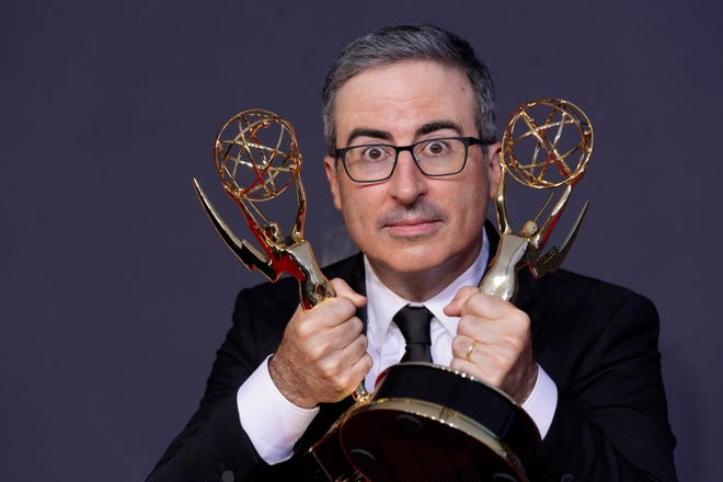 """John Oliver poses for a photo with the awards for outstanding writing for a variety series and outstanding variety talk series for """"Last Week Tonight with John Oliver"""" at the 73rd Primetime Emmy Awards on Sunday, Sept. 19, 2021, at L.A. Live in Los Angeles. (AP Photo/Chris Pizzello) ORG XMIT: CAAH118"""