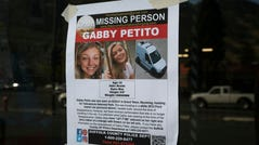 This Thursday, Sept. 16, 2021, photo, shows a Suffolk County Police Department missing person poster for Gabby Petito posted in Jakson, Wyo. Petito, 22, vanished while on a cross-country trip in a converted camper van with her boyfriend.