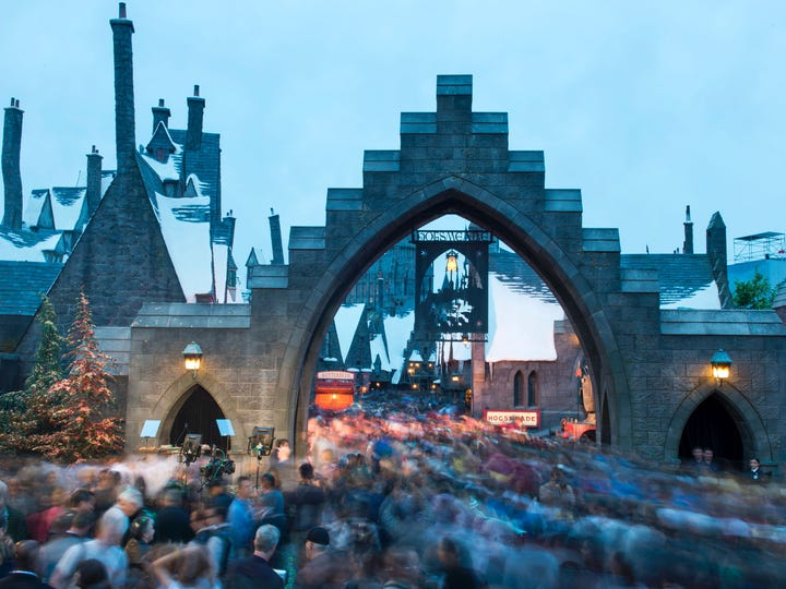 """Fans rush to enter the """"Wizarding World of Harry Potter"""" at Universal Studios Hollywood on April 7, 2016."""