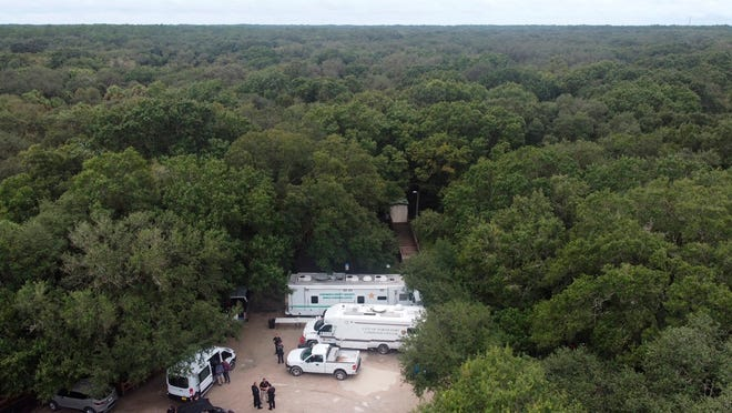 """In this photo provided by North Port Police Department, law enforcement officials conduct a search of the vast Carlton Reserve in the Sarasota, Fla., area for Brian Laundrie on Saturday, Sept. 18, 2021.  Laundrie is a person of interest in the disappearance of his girlfriend, Gabrielle """"Gabby"""" Petito."""