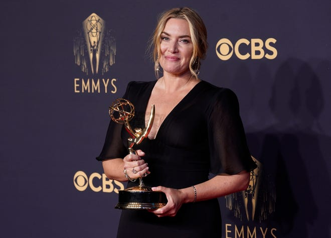 """Kate Winslet, winner of the award for outstanding lead actress in a limited or anthology series or movie for """"Mare of Easttown"""" poses at the 73rd Primetime Emmy Awards on Sunday, Sept. 19, 2021, at L.A. Live in Los Angeles. (AP Photo/Chris Pizzello) ORG XMIT: CAAH190"""