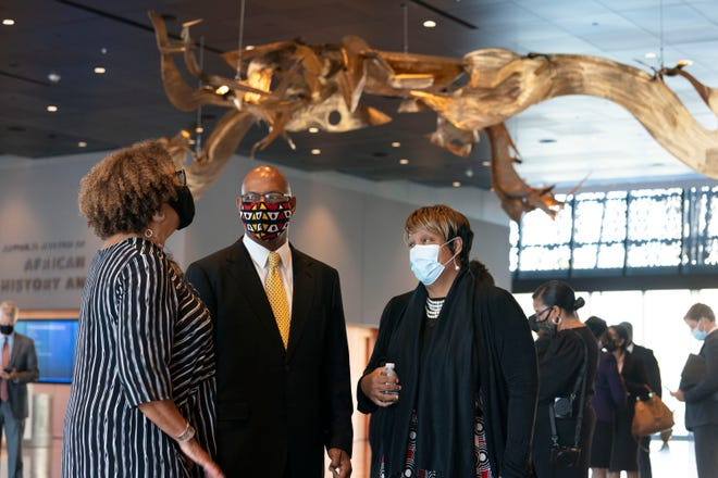 September 20, 2021;  Washington, DC, USA;  Carolita Jones Cope, Vincent Tucker and Wanda Tucker wait for Angolan President Joao Lorenio before visiting the Smithsonian National Museum of African American History and Culture on Monday, September 20, 2021 in Washington DC.  In 1619 the enslaved Angolans were brought to Virginia.