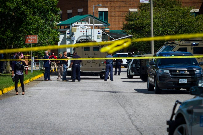 Police respond to a shooting scene at Heritage High School in Newport News, VA, on Saturday, September 20, 2021.