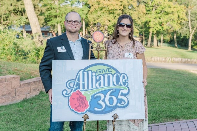 Alliance Give 365 logo designer Dirk Rozich and his wife, Nicole, attended an event Sept. 16 that introduced a new concept for fundraising for philanthropy in the Alliance area.