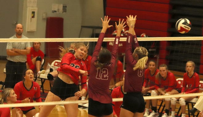 """Senior hitter Gracie West of the 2021 Chillicothe (Mo.) HS volleyball Lady Hornets watches as her spike attempt zips past a 2-person would-be blocking wall by St. Joseph: Benton for a clean winner during the first game of the teams' Monday, Sept. 20, match in Chillicothe. The West """"kill"""" completed the Lady Hornets' 25-23 triumph in the game, but Benton won the next three and the match."""