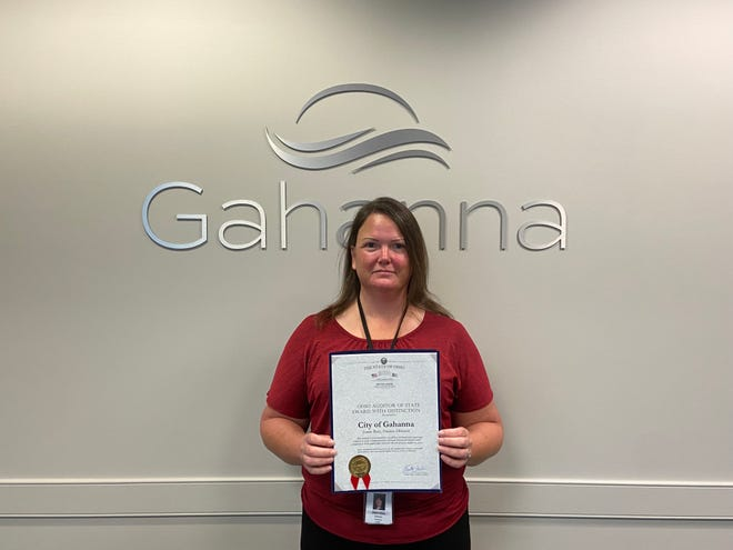 Gahanna finance director Joann Bury displays the city's first Ohio Auditor of State Award with Distinction.