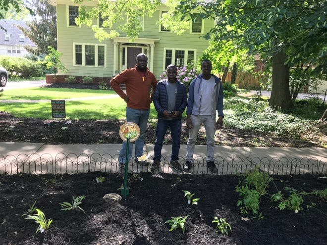 From left: Issoufou Lembane, Idrissa Kiema and Emmanuel Sabo stand in front of a house in Cleveland where they completed gardening work in May.They escaped Burkina Faso and came to the U.S. seeking asylum. An immigration court judge set their bond in 2019 to be released from a detention facility at $15,000, a sum they could not pay without help from the community.