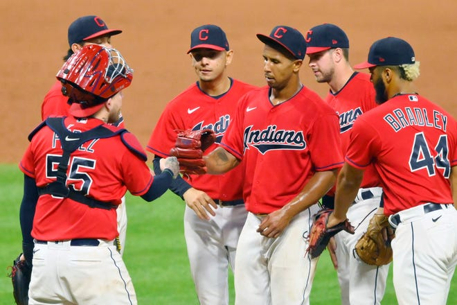 Anthony Gose gets congratulated by his teammates after making his major league debut as a pitcher. [USA TODAY Network]