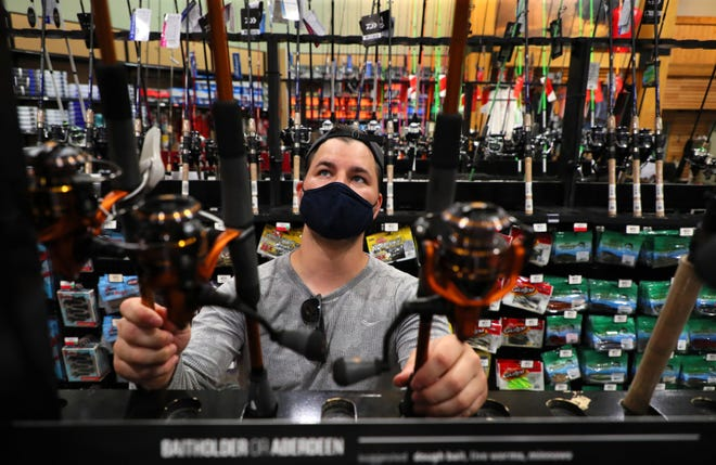 Kevin Sobkowicz of Arlington Heights, Illinois looks over fishing poles and fishing gear at Dick's Sporting Goods. Retail groups are urging consumers to do their holiday shopping early.  (Stacey Wescott/Chicago Tribune/TNS)