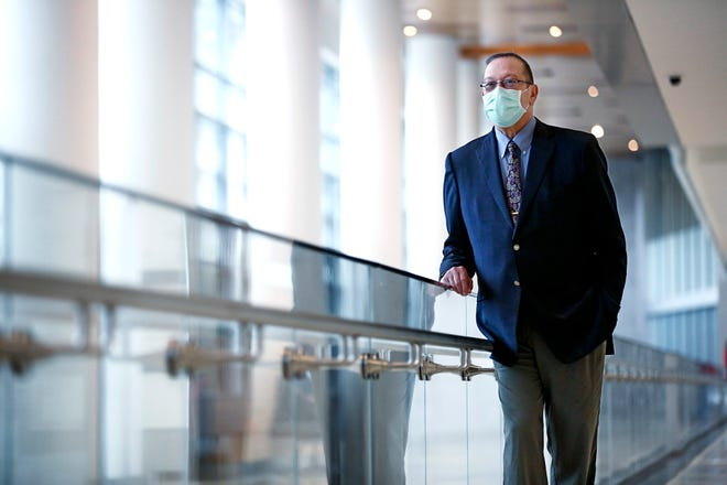 Dr. Raphael Pollock, an oncologist and director of Ohio State's Comprehensive Cancer Center, used his own cancer diagnosis to better relate to and treat patients.